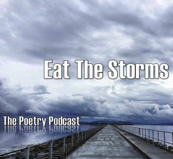 Stormy peer with water, dark sky, and boardwalk